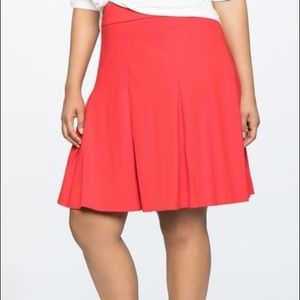 red a-line pleated skirt